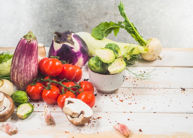 Various fresh organic vegetables on wooden surface