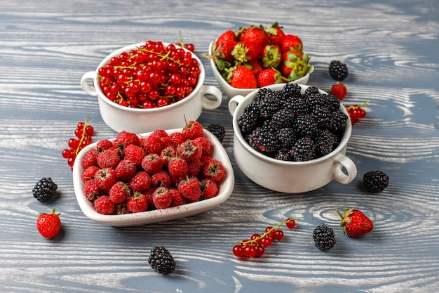 Various fresh summer berries,blueberries,red currant,strawberries,blackberries,top view.