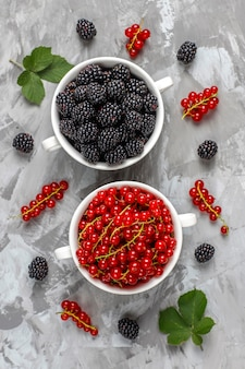 Various fresh summer berries, blueberries, red currant, strawberries, blackberries, top view.