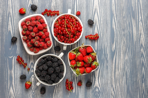 Various fresh summer berries,blueberries,red currant,strawberries,blackberries