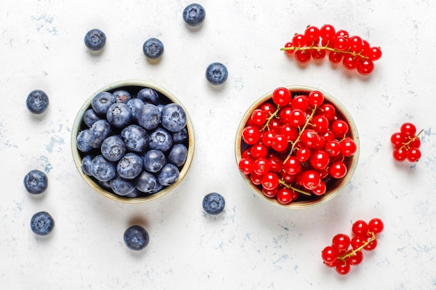 Various fresh summer berries, blueberries, red currant, top view.