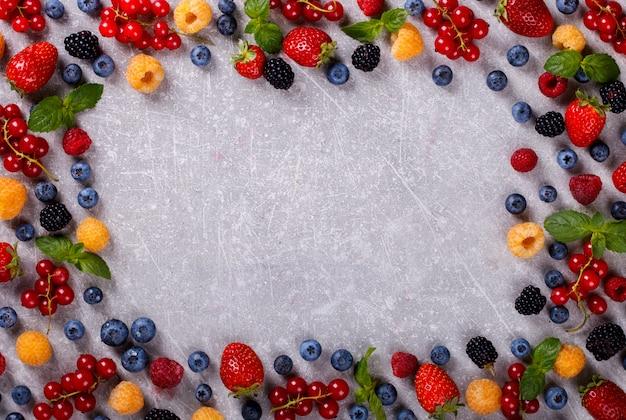 Various fresh summer berries frame