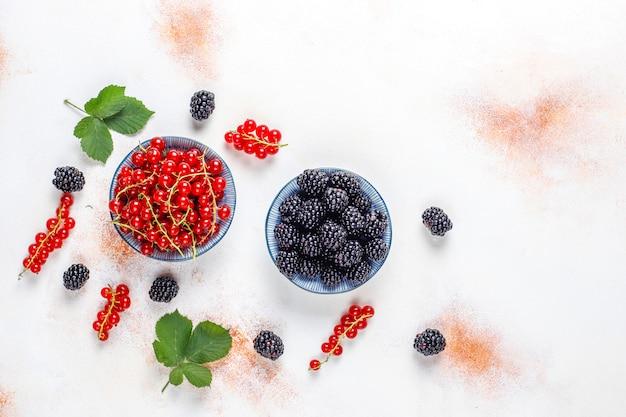 Various fresh summer berries, red currant, blackberries, top view.