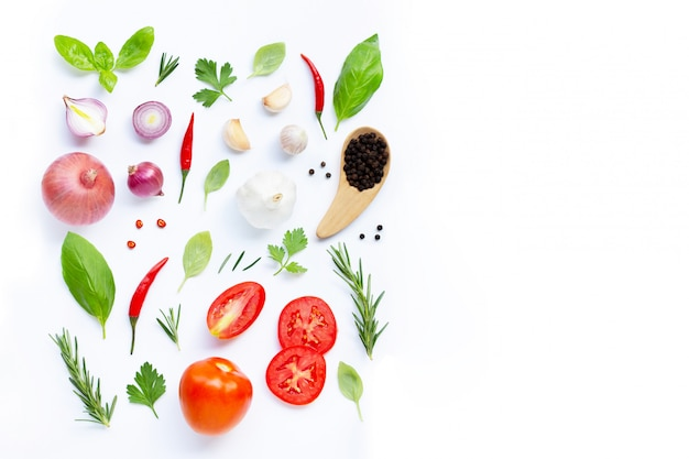 Various fresh vegetables and herbs on white background. healthy eating concept