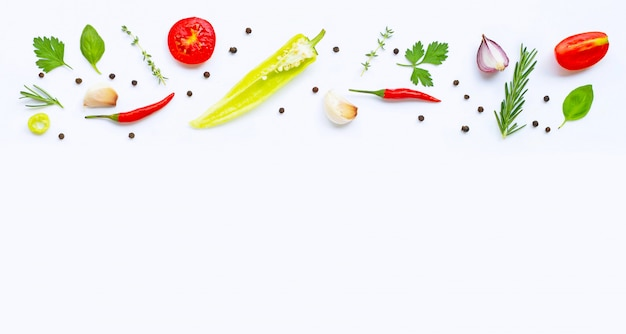 Various fresh vegetables and herbs on white background with copyspace. healthy eating concept