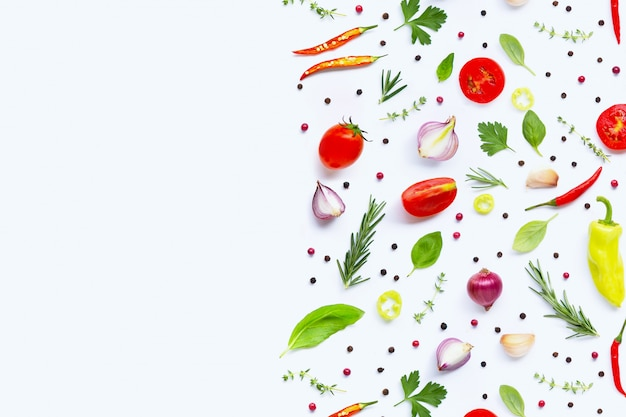 Various fresh vegetables and herbs on white. healthy eating concept