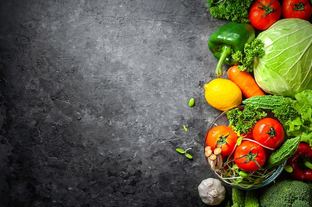 Various fresh vegetables organic food for healthy on rustic background with copy space