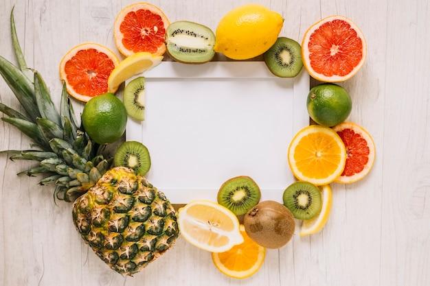 Various fruits around frame