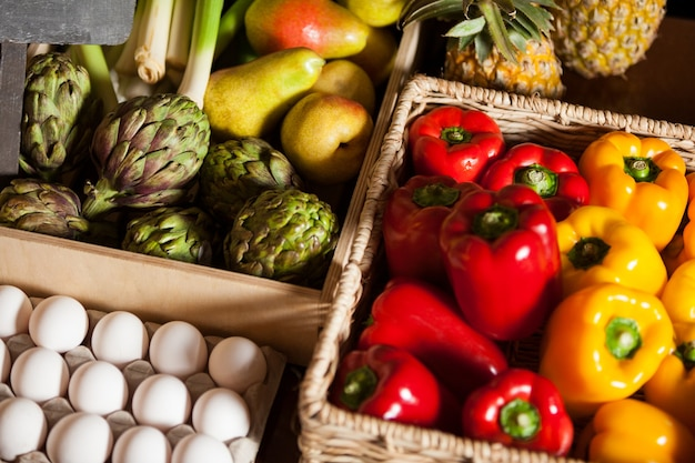 Various fruits, vegetables and eggs in organic section