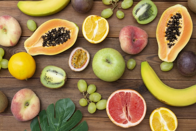 Various fruits on wooden background. summer concept.