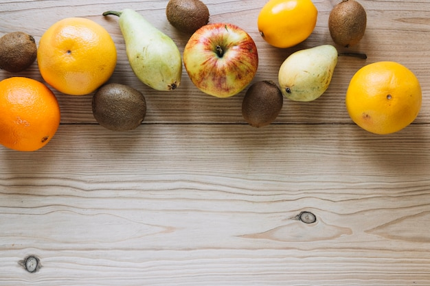 Various fruits on wooden tabletop
