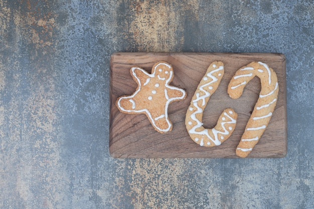 Various gingerbread cookies on wooden board. high quality photo