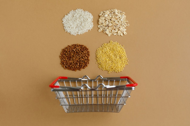Various groats in grocery basket. rice and oatmeal buckwheat and millet