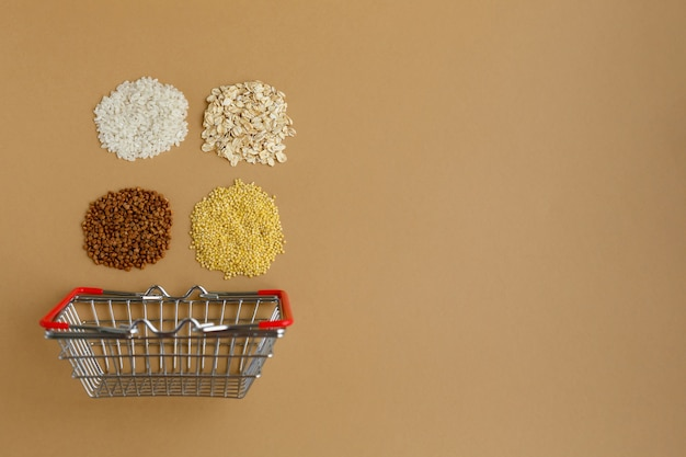 Various groats in grocery basket rice and oatmeal buckwheat and millet