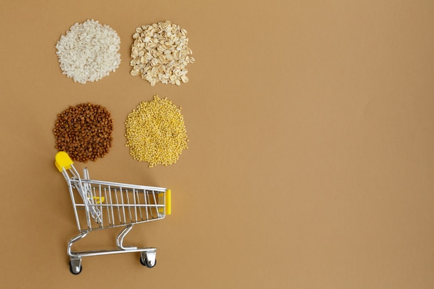 Various groats in grocery cart rice and oatmeal buckwheat and millet