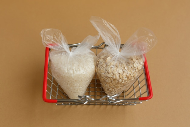Various groats in packages in grocery basket rice and oatmeal