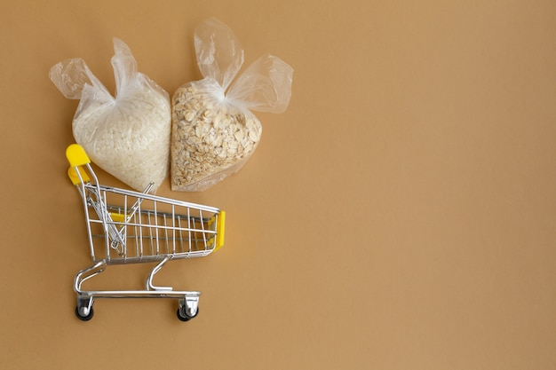 Various groats in packages in grocery cart rice and oatmeal