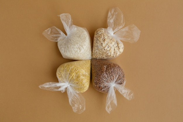 Various groats in small plastic bags rice and oatmeal buckwheat and millet