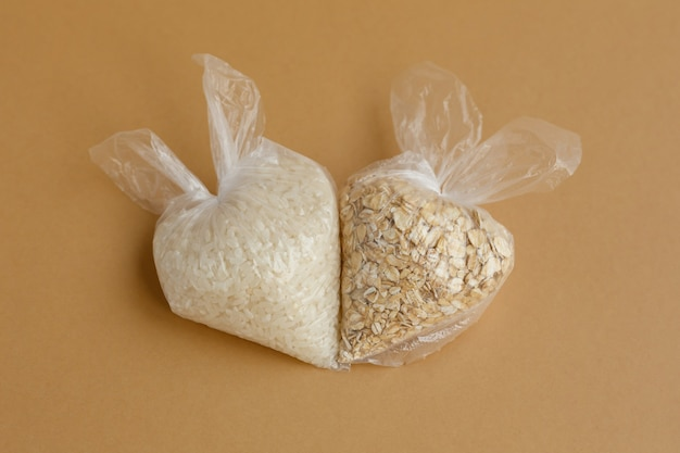 Various groats in small plastic bags rice and oatmeal