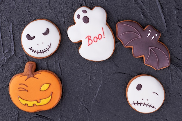 Various halloween biscuits on black background.