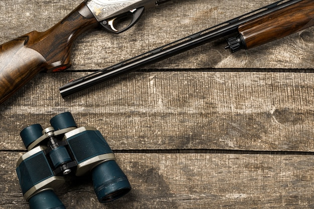 Various hunting equipment on old wooden background