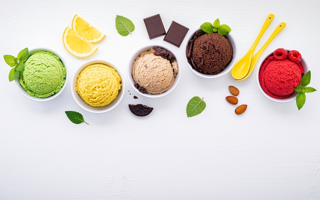 Various of ice cream flavor ball set up on white wooden background .