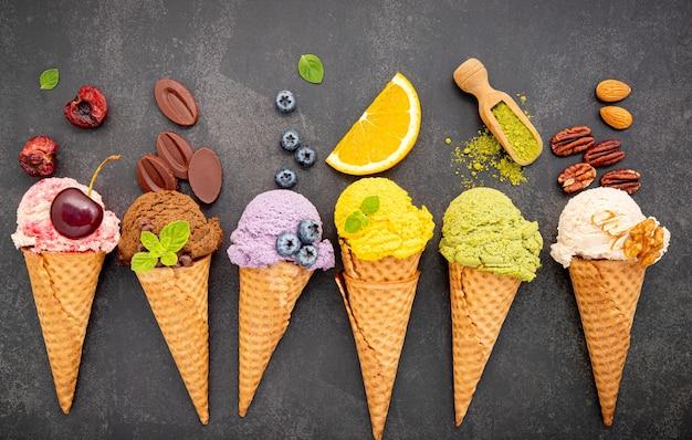 Various of ice cream flavor in cones setup on dark stone