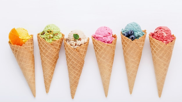 Various of ice cream flavor in cones setup on white background for sweets menu design.