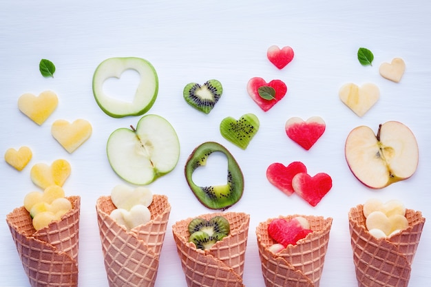 Various of ice cream flavor in cones setup on white background .
