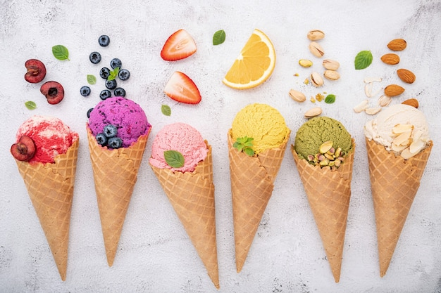 Various of ice cream flavor in cones  setup on white stone background