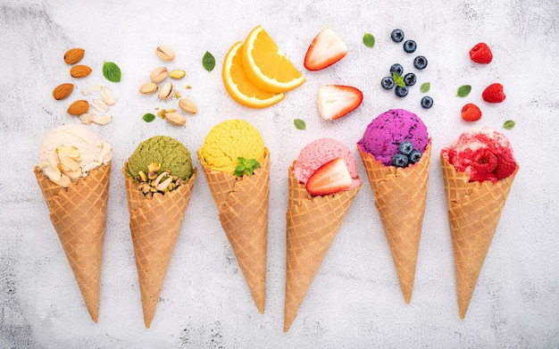 Various of ice cream flavor in cones  setup on white stone .
