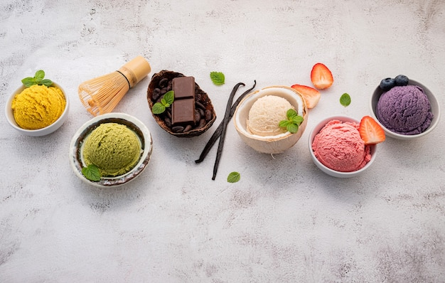 Various of ice cream flavors in bowl  setup on white stone background