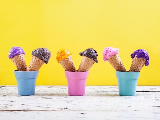 Various ice-cream scoops on yellow