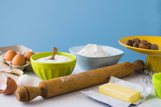 Various ingredients for making cake on table
