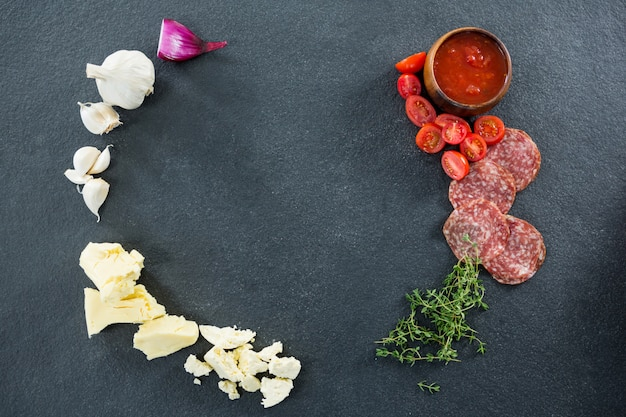 Various ingredients with tomato and salami