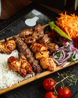 Various kebab with rice and vegetables
