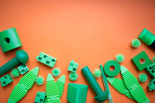 Various kids toys background in green colours, colorful assorted