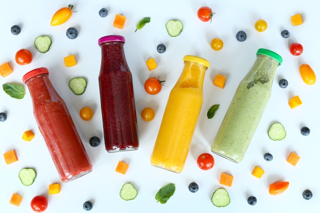 Various kind of smoothies or juices in glass bottles