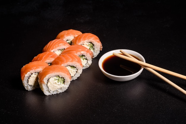 Various kinds of sushi served. roll with salmon, avocado, cucumber. sushi menu. japanese food.