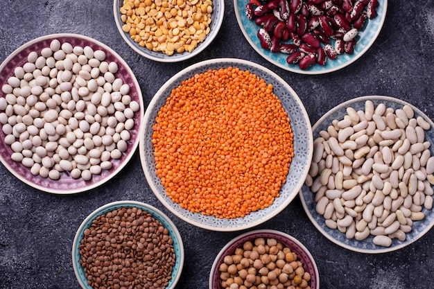 Various legumes. chickpeas, red lentils, black lentils, yellow peas and beans. selective focus. top