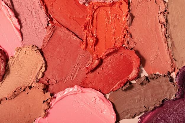 다양한 립스틱이 번졌습니다. 매트 립스틱 질감 배경입니다. 화장품 샘플
