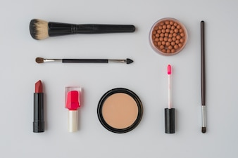 Various makeup products on white background