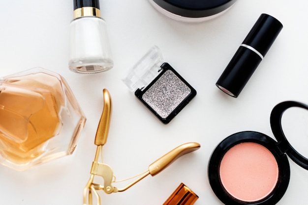Various makeup products on white table