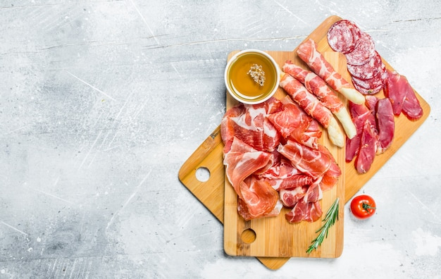 Various meats on wooden table
