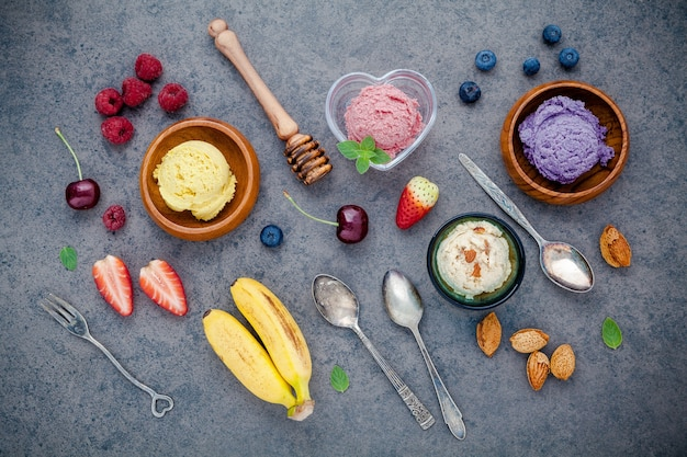 Various mixed fruits on dark stone background for sweets menu design.