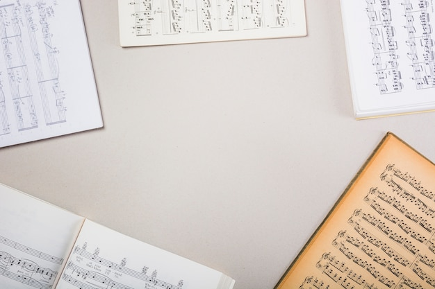 Various musical note books on white background with space for text