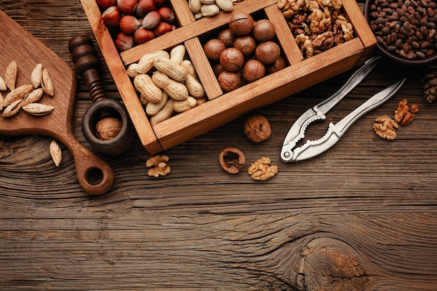 Various nuts on a wooden table. top view with copy space.