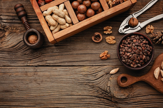 Various nuts on a wooden table.