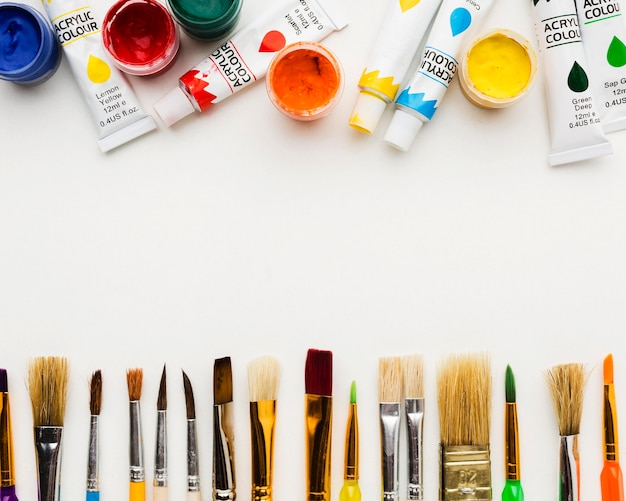 Various paint brushes and watercolor tubes