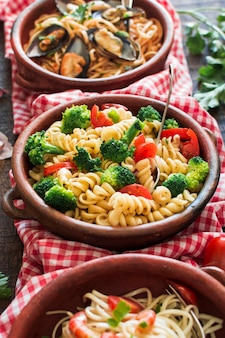 Various pasta salad in the earthenware